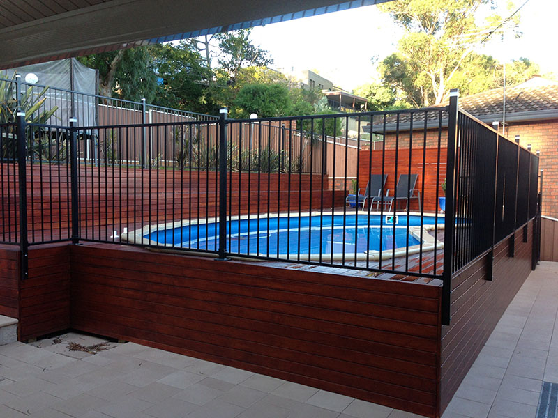 above ground pool with deck surround. treated pine decking, powder coated pool fence around an above ground pool, steel pergola with deck surround n